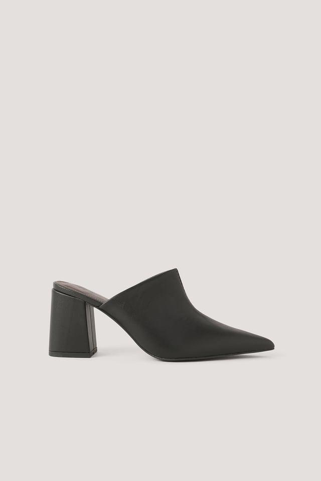 Black Mules Asymétriques À Coutures Apparentes