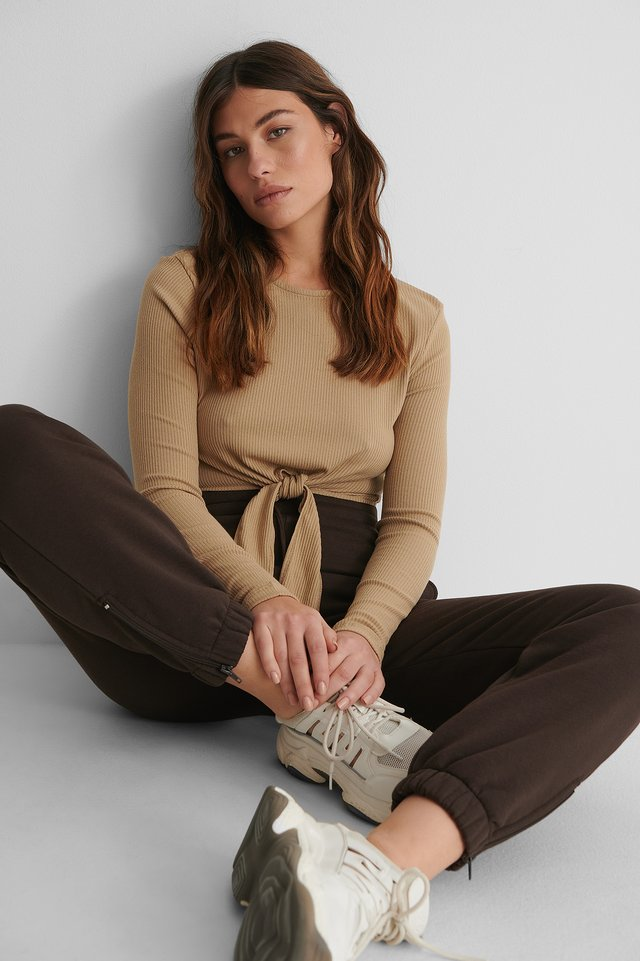 Ribbed Knot Detail Top with Sweatpants and Sneakers.