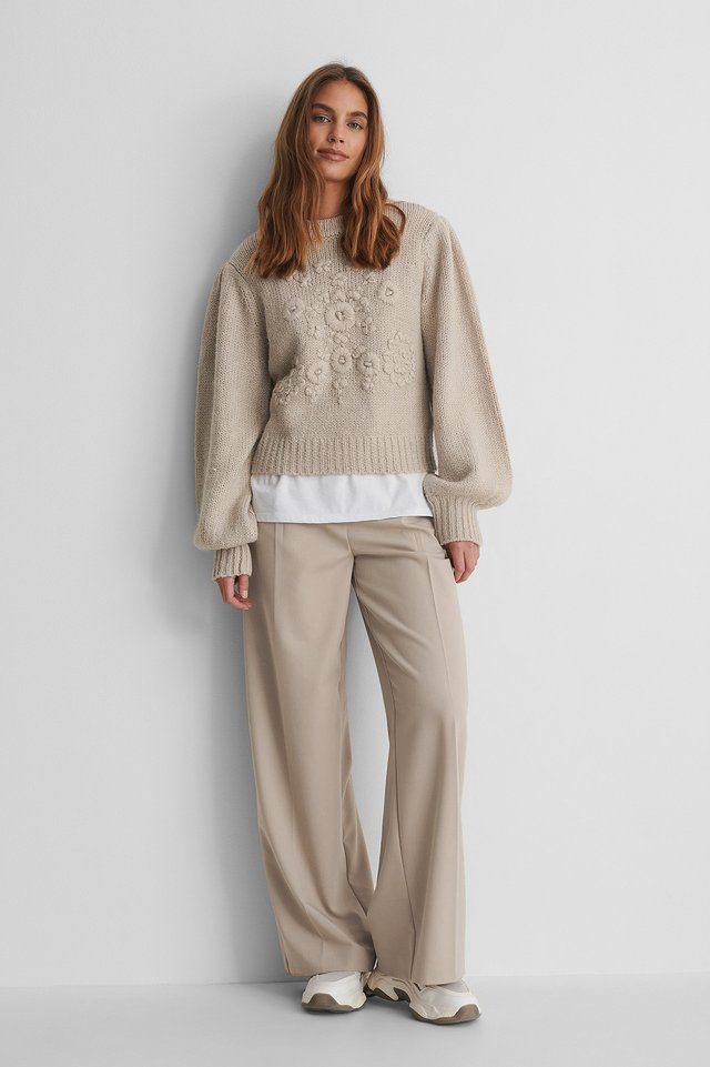 Flower Knitted Sweater with Suit Pants and Sneakers.