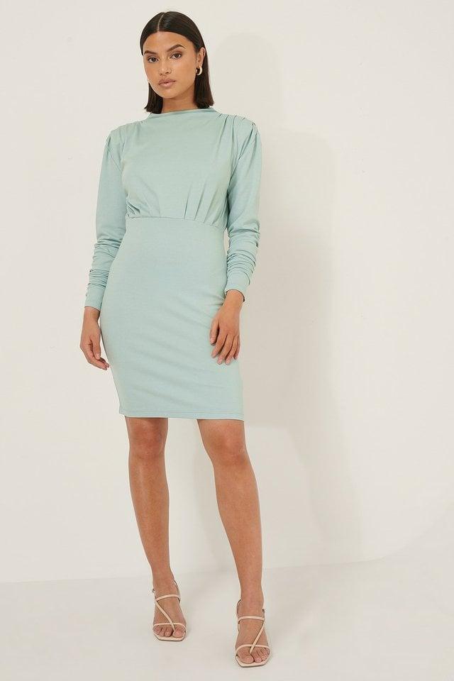 Big Shoulder Jersey Dress Outfit.