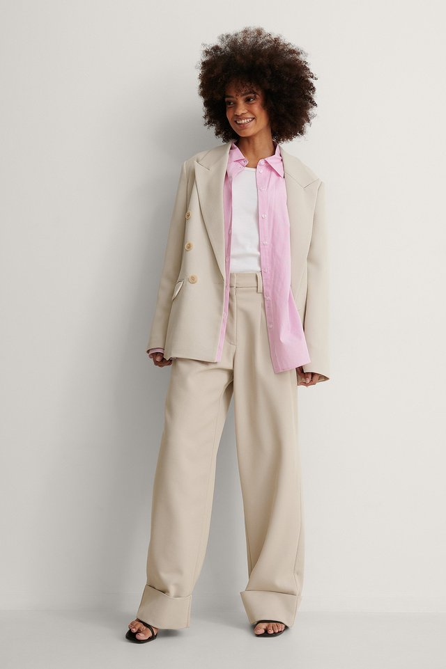 Small Stripe Oversized Shirt with a tank, matching suit set and heeled sandals.