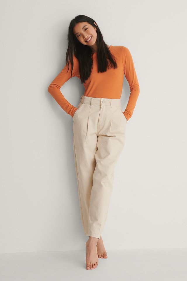 Style this top with suit pants for a cute, cozy and fancy outfit for the day. A fresh look for a fresh start in the day.